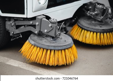 Close-up sweeper machine cleaning streets. Concept clean from debris.