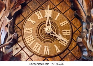 Closeup of Swiss Cuckoo Clock Face with Ornate Hands and Roman Numerals