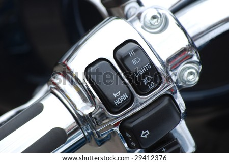 Close-up of switches on a motorcycle handlebar