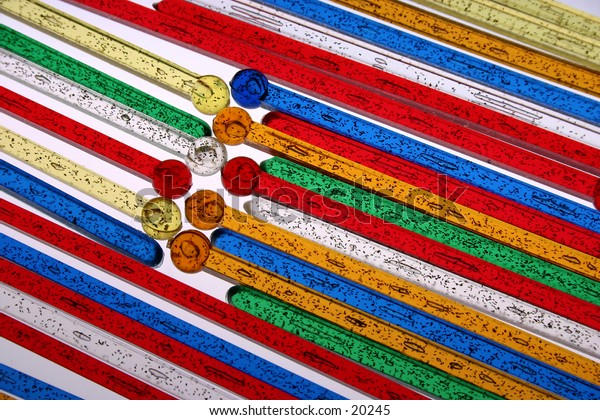 closeup of swizzle sticks, backlit
