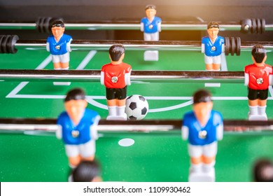 Close-up of Table football soccer game on green field (game that requires a hand flick)