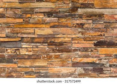 Close-up of tacked slate stone wall.