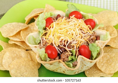 Closeup of a taco salad in a tortilla shell with chips