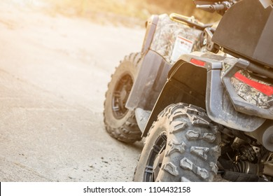 Close-up tail view of ATV quad bike. Dirty whell of AWD all-terrain vehicle. Travel and adventure concept.Copyspace.Toned