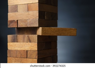 Closeup take one block on The tower from wooden blocks, dark tone.
