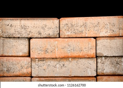 Closeup take of a weathered stone wall with its worn texture
