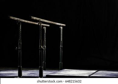 Closeup. Talcium powder over gymnastic parallel bars. Gymnastic parallel bars. Isolated on black background,