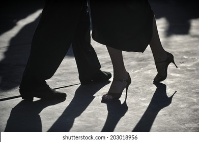 close-up of Tango dancers'?? foot step on pebble in silhouette