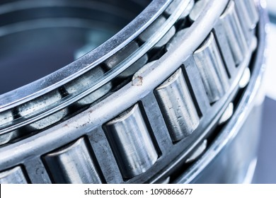 Close-up of a tapered roller bearing. Abstract industrial background.