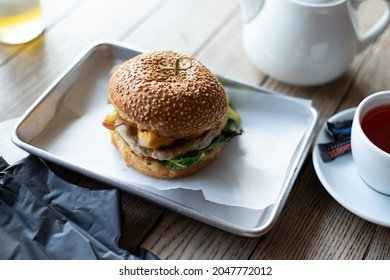Close-up of tasty burger on wooden table.
