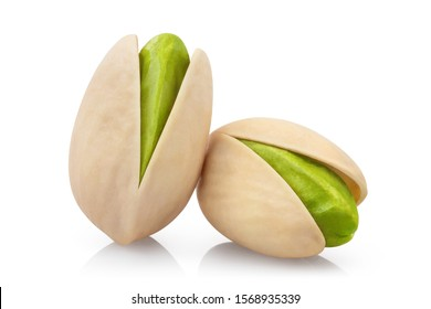 Close-up of tasty pistachios, isolated on white background