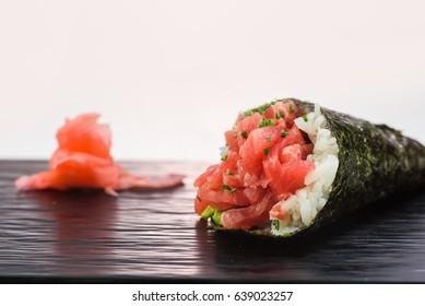 Close-up of tasty tuna hand roll sushi temaki. Japanese traditional cuisine