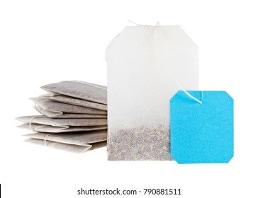 Close-up of tea bags isolated on white background. Blue label.