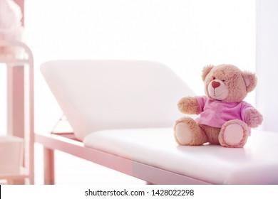 Closeup of teddybear on bed at hospital