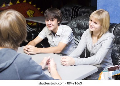 Close-up of teenagers sitting at the table