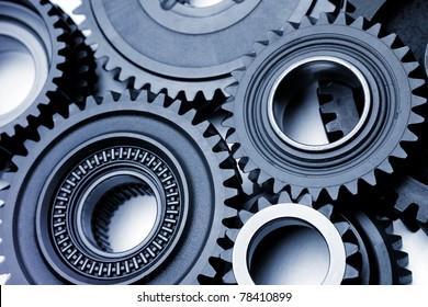 Closeup of teeth of steel gears meshing together
