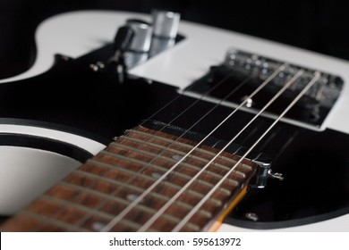 Close-up of Telecaster style guitar