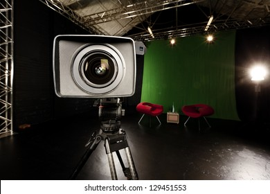 Close-up of a Television Camera lens in a green screen studio environment.