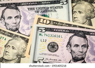 Closeup of ten and five dollar bills. Concept of 15 dollar federal minimum wage increase.