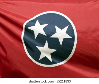 A close-up of the Tennessee state flag waving in the wind.