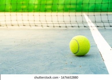 close-up tennis ball on tennis court with copy space