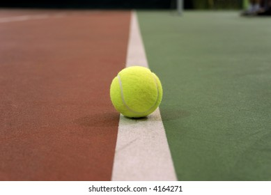 Close-up tennis ball on the court