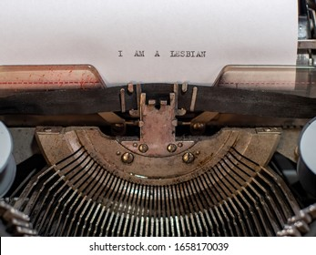 close-up text I AM A LESBIAN. old vintage typewriter with a sheet of white paper