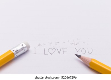 "closeup of text "" I LOVE YOU"" with  pencil eraser and pencil"