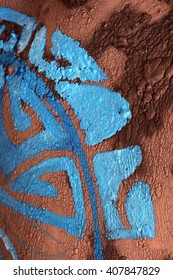close-up texture fragment pattern of blue paint on the body in clay