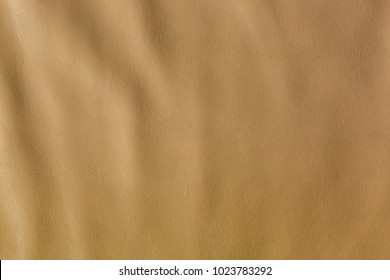 Closeup texture of natural brown leather background with wrinkle pattern