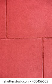 Closeup texture of new red painted fake bricks on a wall background