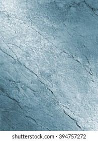 Closeup of texture on surface of stone wall toned blue.