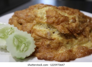 Close-up of Thai Minced Pork Omelet on Rice - Kao Kai Jeaw Moo Sap - Thai cheapest delicious famous comfort food /street food.