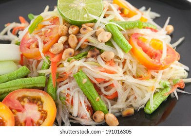 Closeup Thai papaya salad serve with vegetables