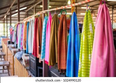 Closeup Thai silk cloth hanging in store in Thailand.