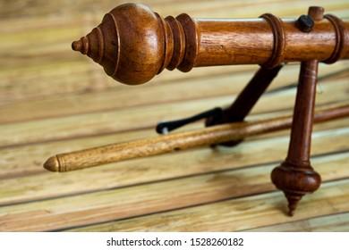 Closeup Thai treble fiddle, popular Northern Thai instrument on bamboo bench