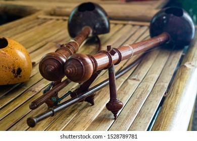 Closeup Thai treble fiddles, Northern Thai instrument on bamboo bench