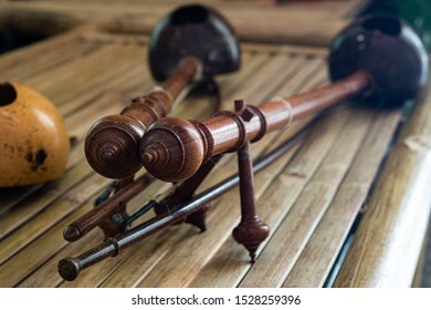 Closeup Thai treble fiddles, popular Nothern Thai instrument on bamboo bench