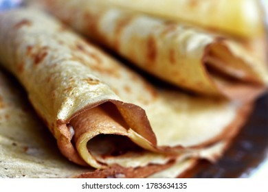 Closeup of the thin folded pancakes, detail of the crunchy edge of the pancake.