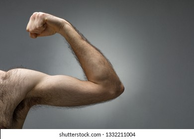 Close-Up of a Thin Hairy Arm Contracting the Biceps