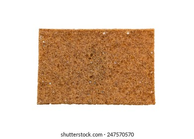 Closeup of a thin rye crispbread with sourdough rye, viewed from above, isolated on white background