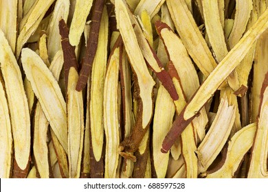 Closeup thinly sliced licorice root (Liquorice) used as herbal medicine (Glycyrrhiza glabra)
