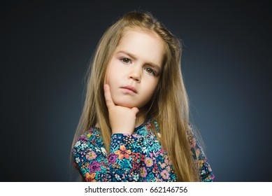 Closeup Thoughtful girl with Hand at head isolated on Gray