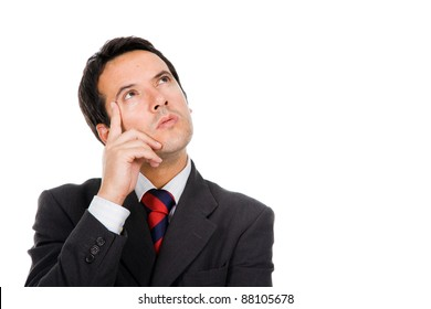 Close-up of a thoughtful young business man against white background