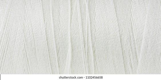 Closeup of thread wuond on spool.