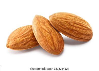 Close-up of three almonds, isolated on white background