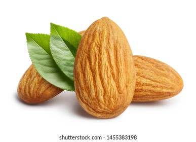 Close-up of three almonds with leaves, isolated on white background