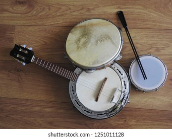 Close-up of three Brazilian musical instruments: samba banjo, pandeiro (tambourine) and tamborim with drumstick. They are widely used to accompany samba, the most famous Brazilian rhythm.