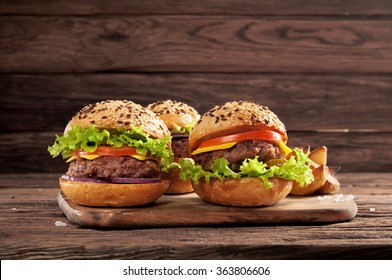 Closeup three different burgers on wooden background