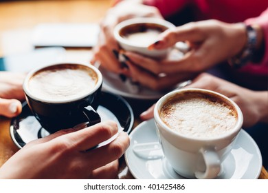 Closeup of three girls with coffee cups